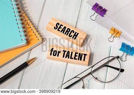 Search For Talent - Words Written On Wooden Blocks Near Office Supplies