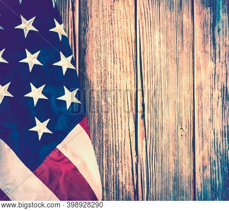 American Flag Over Vintage Or Antique Wooden Background With Copy Space For Memorial Day And Veteran