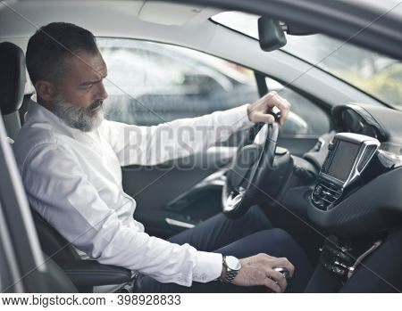 adult man behind the wheel