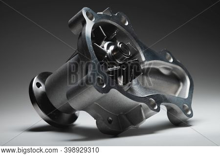 Ice Liquid Cooling Pump. Engine Coolant Pump. Contrast Light On Gray Background