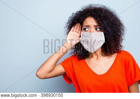 Close-up Portrait Of Pretty Worried Wavy-haired Girl Wearing Safety Mask Overhear News Copy Space Is