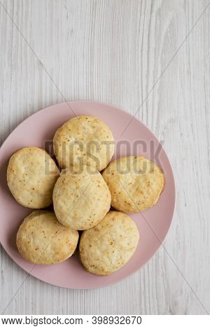 Homemade Flaky Buttermilk Biscuits On A Pink Plate On A White Wooden Surface, Top View. Flat Lay, Ov