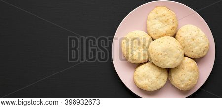 Homemade Flaky Buttermilk Biscuits On A Pink Plate On A Black Surface, Top View. Flat Lay, Overhead,