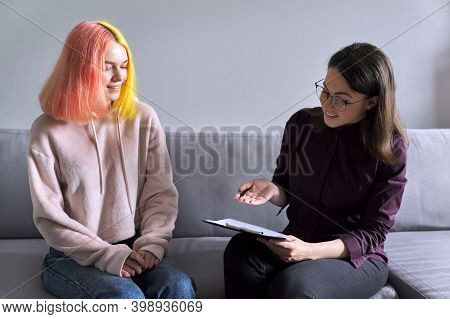 Teen Girl Giving Interview To Social Worker. School Psychologist Talking With Student, Counseling, T
