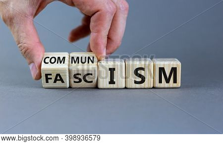 Communism Or Fascism Symbol. Male Hand Turns Cubes And Changes The Word 'fascism' To 'communism'. Be