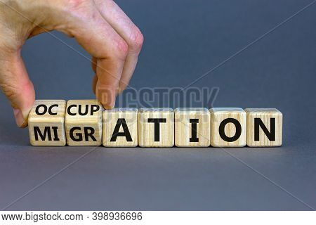 Migration Or Occupation Symbol. Male Hand Turns Cubes And Changes The Word 'migration' To 'occupatio
