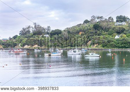 Oban New Zealand November 2 2020; Boats Moored Below Homes On Hill Surrounding Half Moon Bay On Stew