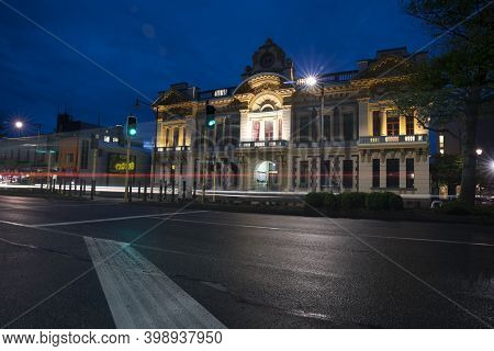 Invercargill New Zealand - October 30 2020; Night On City Street With City Hall Illuminated Displayi
