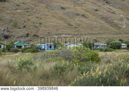 Christchurch New Zealand - November 21 2020; Typical Iconic Holiday Home Batches On Beach At Taylors