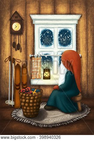 Scandinavian Gnome Sitting At Home On Stool By The Window With Alight Lantern, Skis, Basket Of Gifts