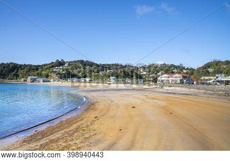Oban New Zealand - November 2020; Long Curving Beach Of Half Moon Bay And Village On Stewart Island,