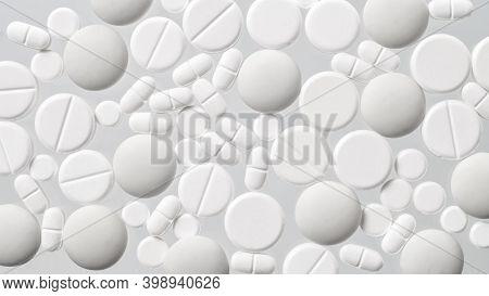 Various White Medical Pills On White Background