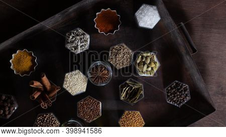 In Hexagonal Jars Appear On A Metal Rusty Baking Sheet
