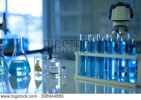 Row Of Blue Liquid Chemical Tube In Laboratory, Science And Technology Healthcare Concept