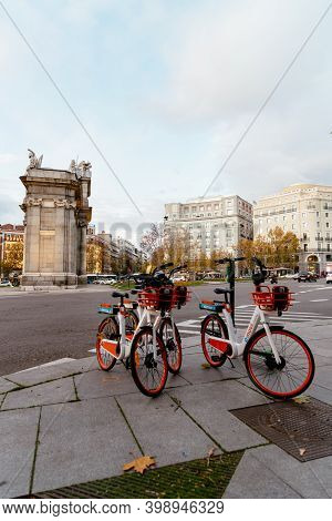 Madrid, Spain - December 6, 2020: Rental Electric Bicycles At Plaza De La Independencia Or Independe