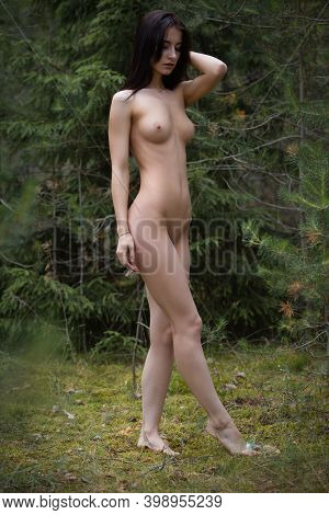 Gorgeous Nude Brunette Woman With A Beautiful Body In The Forest Enjoying Nature