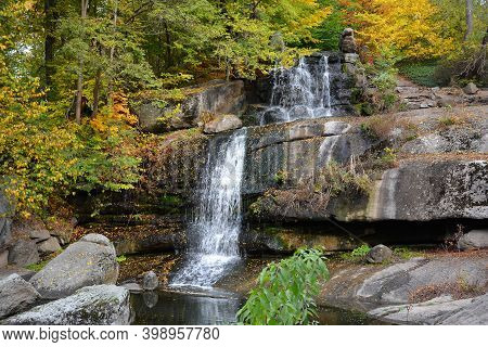 Autumn Colors In The National Dendrology Park Of Sofiyivka, Uman, Ukraine. Waterfall In The Park.