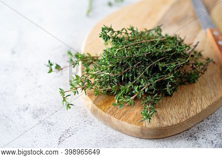 Raw Fresh Thyme Leaves On A Background