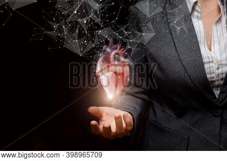 Business Woman Showing Heart On Dark Background.