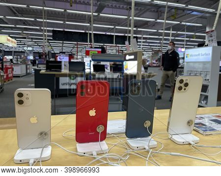 Frankfurt, Germany - December 10th 2020: A German Photographer Comparing The New Iphone 12 As Well A