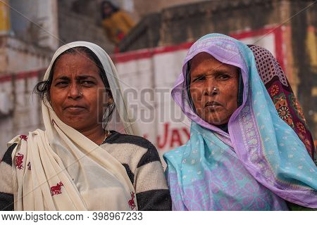 Varanasi, India - Dec 23, 2019: Unidentified Indian Women With Her Colorful Scarf. Scarf Made Of Ind