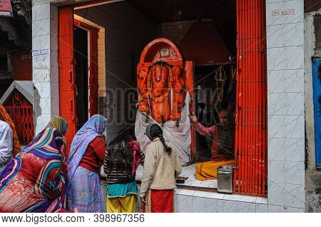 Varanasi, India - Dec 24, 2019: Unidentified Indian Women With Her Colorful Scarf. Scarf Made Of Ind