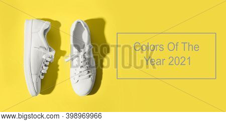 Banner With Grey Female Gumshoes On Yellow Background. View From Above. Space For Text.