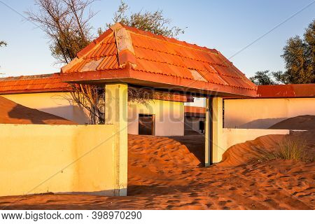 Courtyard Entry Gate With Tile Roof Buried In Sand In The Desert In Abandoned Al Madam Ghost Town, S