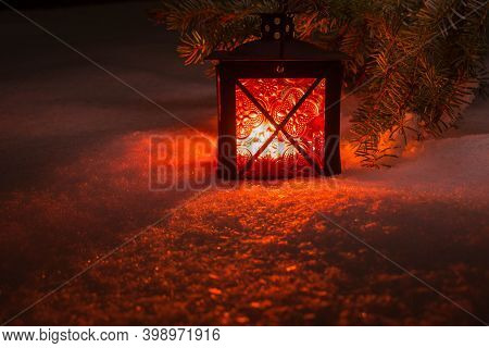 Christmas Lantern On The Snow In The Winter Evening Forest. New Year's And Christmas.