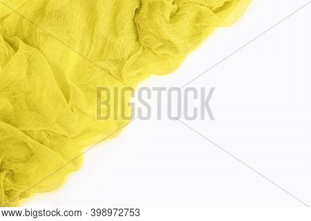 Top View Of Yellow Colored Gauze Fabric Isolated On White Background With Copy Space. Trendy Colors