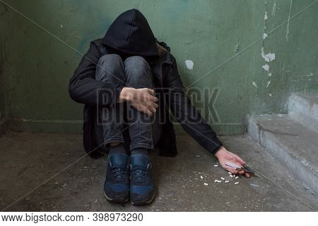 A Male Drug Addict Experiencing A Drug Addiction Crisis After Prolonged Use Of Drugs And Alcohol. Ad
