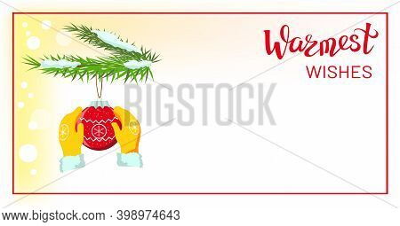 Hands In Yellow Mittens, Gloves Holding Red Christmas Bauble, Christmas Ball Decoration, Hanging On