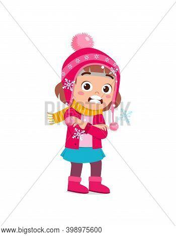 Happy Cute Little Kid Play And Wear Jacket In Winter Season. Child Feeling Chill Wearing Warm Clothe