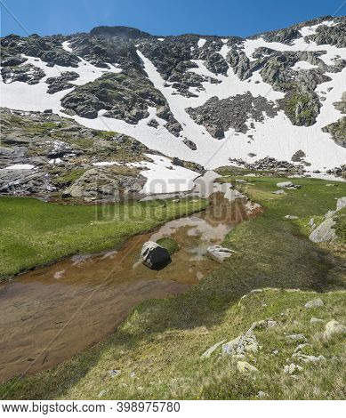 Beautiful Wetland From Spring, Melting Ice And Snow, Alpine Mountain Meadow Called Paradies With Lus