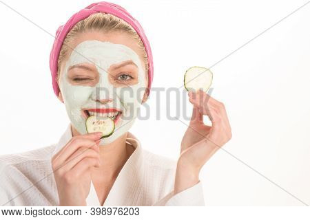 Woman With Facial Mask. Spa Salon. Cosmetic Mask With Cucumber. Natural Beauty. Perfect Skin. Woman