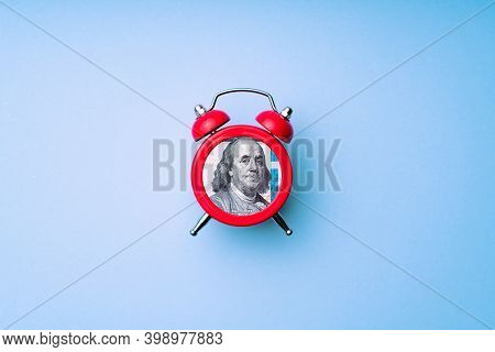 Us Dollar Bill In Alarm Clock. Concept Of Deadline To Invest. Time Is Money Idea. Time To Making Mon