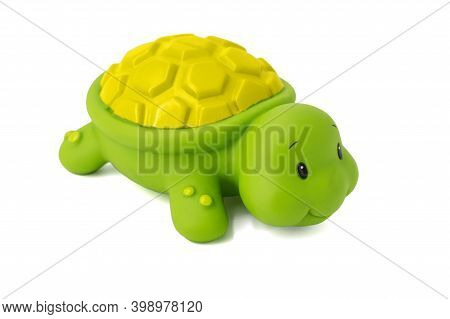 Rubber Toy Green Turtle On A White Background. Child's Toy Green Turtle Isolated Over White Backgrou