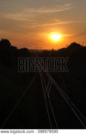 Reflection Of Railroad On Sunset. Industrial Concept Background. Railroad Travel, Railway Tourism.