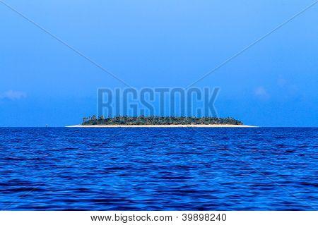 Beautiful Fiji atoll island with white beach