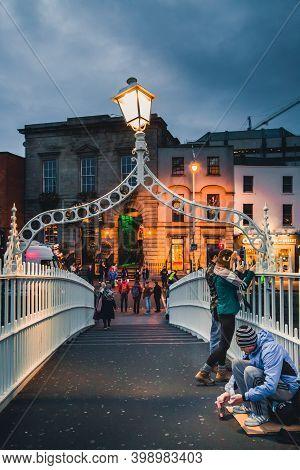 Dublin, Ireland - November 8, 2018: The Ha'penny Or Half Penny Bridge Across The Liffey River. Exter