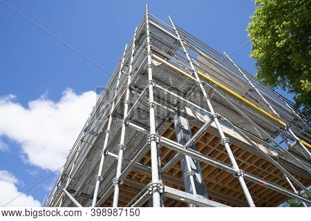 Scaffolding Erected On Building Corner From Low Point Of View.