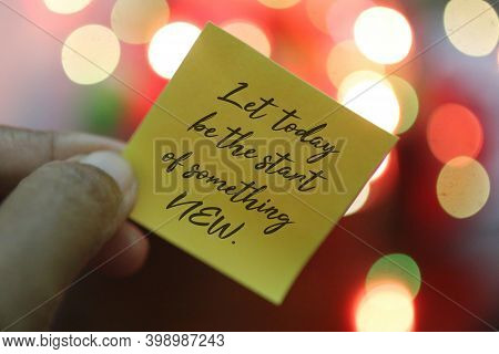 New Year Inspirational Motivational Quote On A Paper Note In Hand - Let Today Be The Start Of Someth