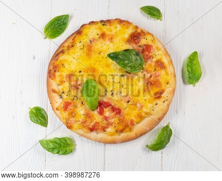 Pizza With Cheese And Tomatoes On White Wooden Background