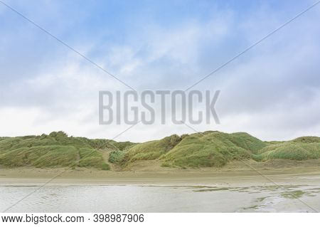 Windswept Oreti Beach Where Cars Can Drive On The Sand With Dunes And Vegetation On Raw Windy Day On