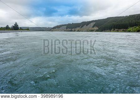 Surging Water Of Rakaia River In Canterbury, New Zealand.