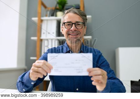 Holding Bank Payroll Check. Finance Cheque In Hands