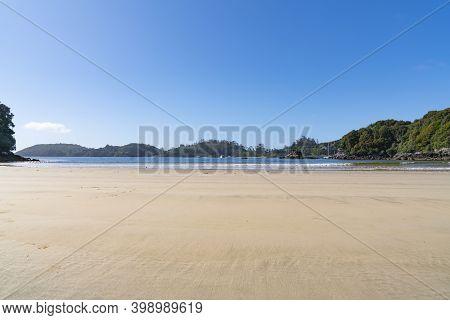 Wide Sandy Landscape Of Bathing Bay At Low Tide, Stewart Island.