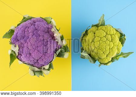 A Green And A Viiolet Cauliflowers  On A Colofred Surface