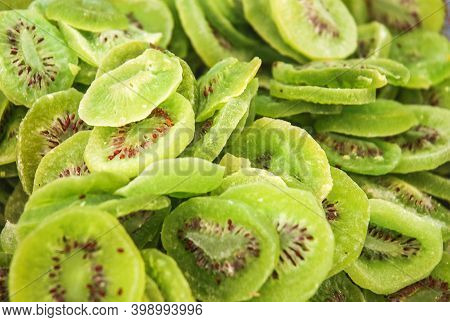 Background With Close Up Of Dried Fruit - Green Kiwifruits On A Stall