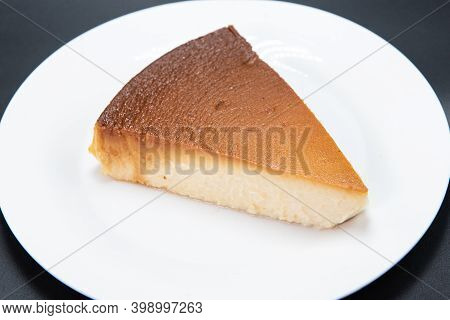 Delicately Prepared Mexican Flan Sweet And Savory Dessert Alone On A White Plate